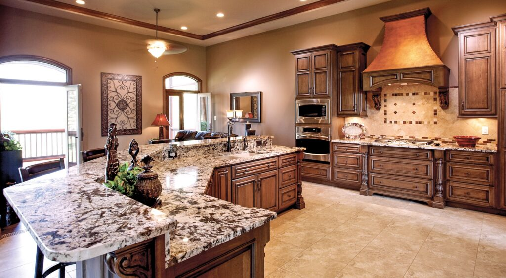 Kitchen with granite countertops and dark brown cabinetry