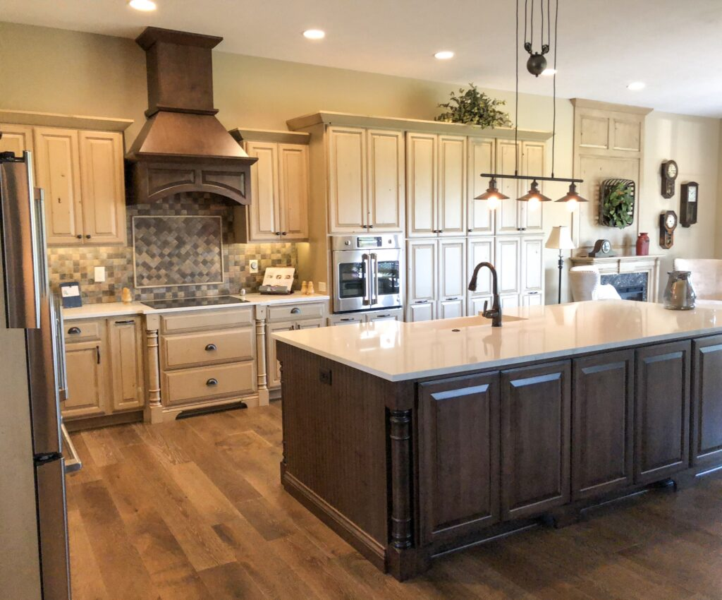 kitchen with cream cabinets and dark brown island