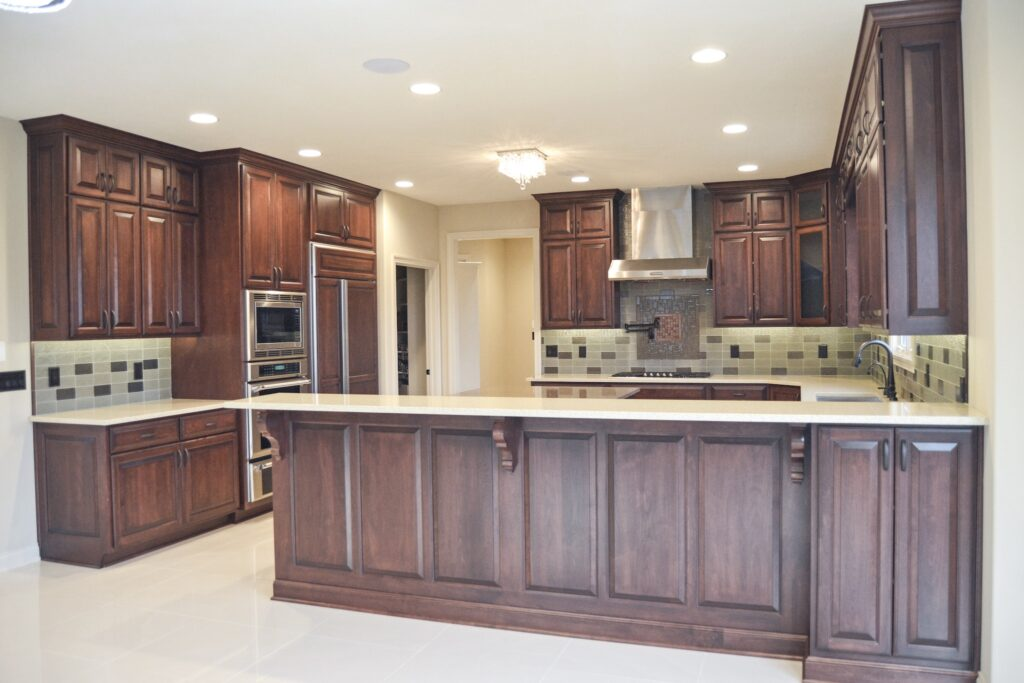 kitchen with dark brown cabinets and tile backsplash