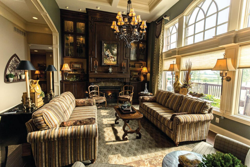 living room with striped couches and brown fireplace with built in shelves