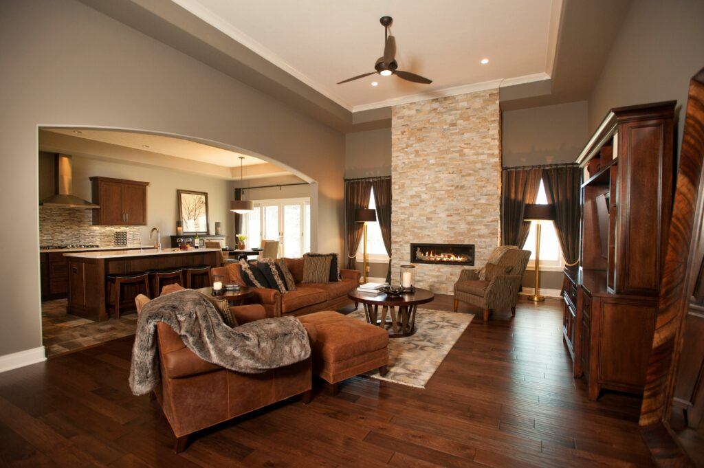 living room with fireplace in the center of wall