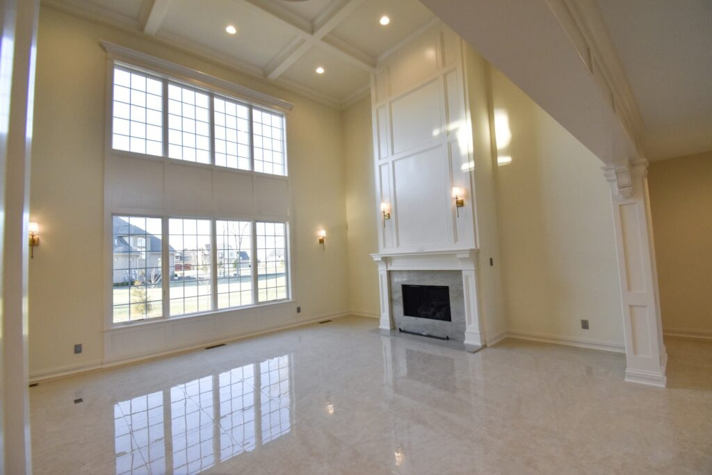 living room with marble floor with white fireplace