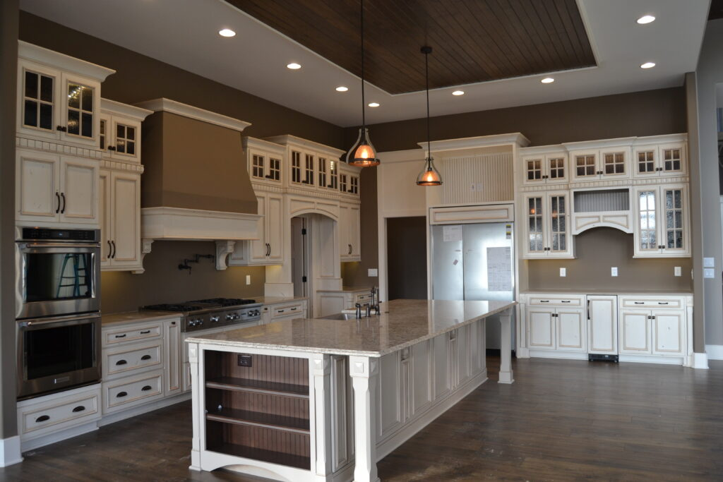 kitchen with white cabinets and dark brown wood flooring