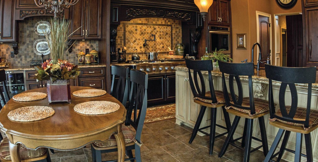 kitchen with dark colors tan cabinets with dark brown accents