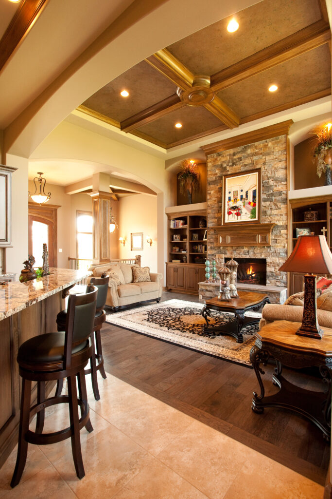 living room with stone fireplace and brown built in shelves