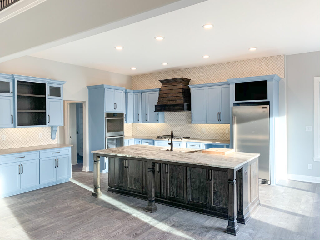 kitchen with blue cabinets and brown accents