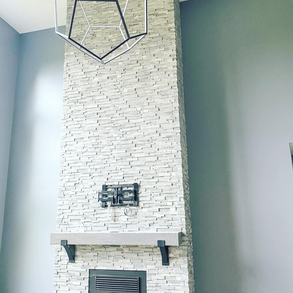 stone fireplace against blue walls